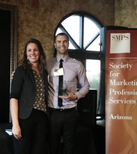 Travis accepts the 2017 Presidents Choice award from SMPS Arizona.