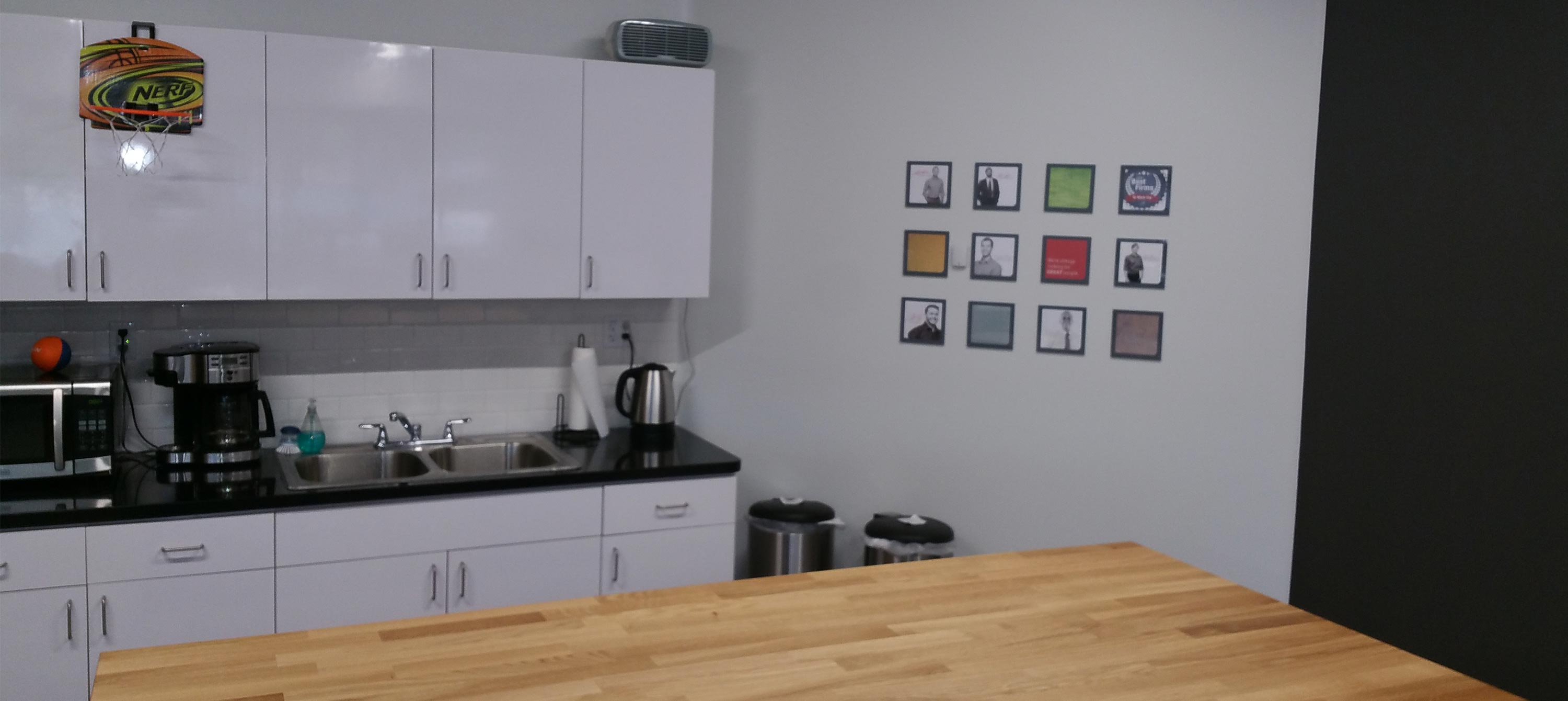 View of the finished kitchen area and people wall in the Schaefer Phoenix office.