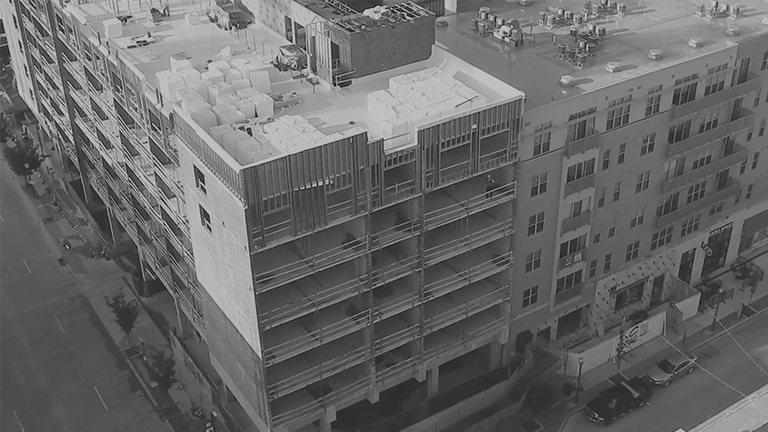 Grayscale aerial shot of the Banks development under construction in Cincinnati, Ohio.