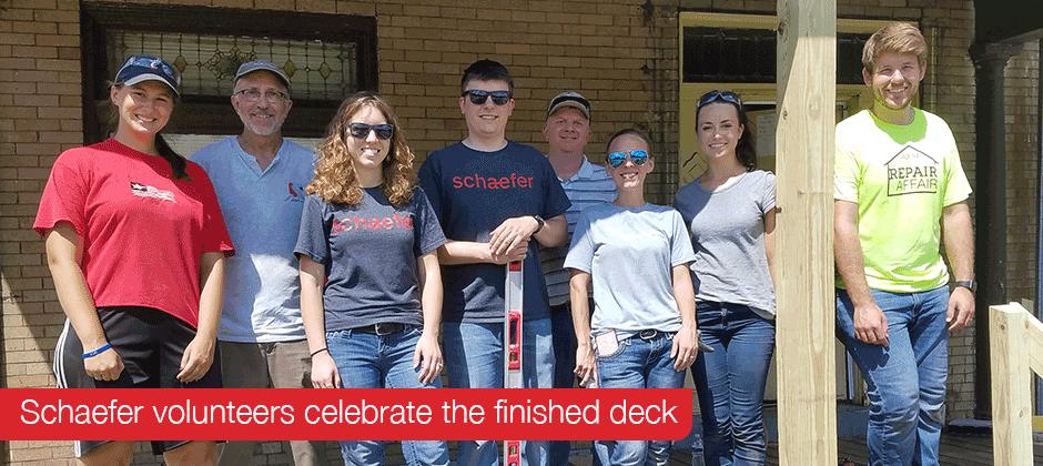 Schaefer volunteers celebrate the finished deck