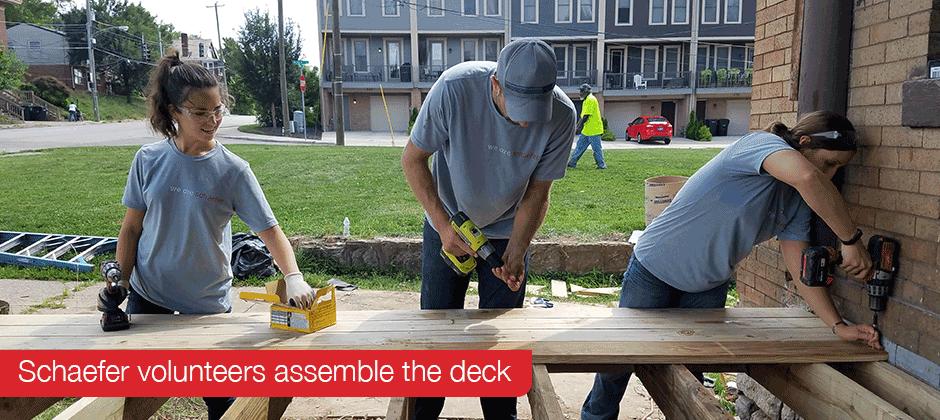 Schaefer volunteers assemble the deck