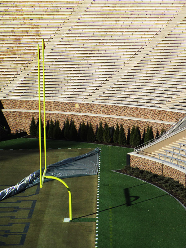 Aerial view of the field goal net rigging at a college football stadium in the United States.