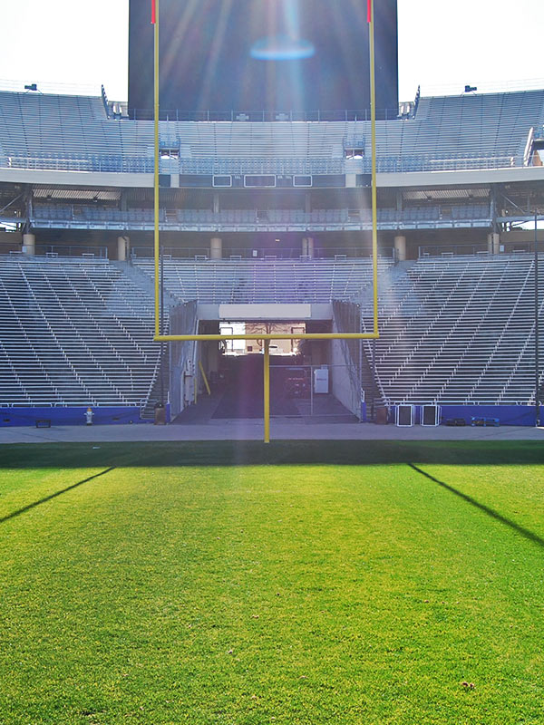 View from the football field of the field goal net rigging at a college football stadium in the United States.