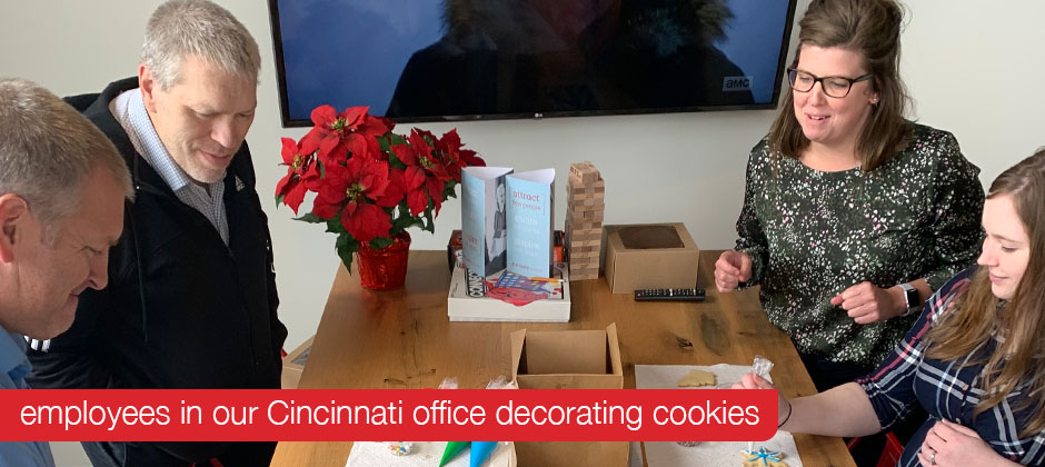 Employees in the Cincinnati office decorating cookies for Schaefer's 2019 Cookies for a Cause campaign.
