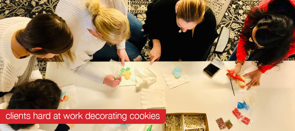 Clients decorating cookies for Schaefer's 2019 Cookies for a Cause campaign.
