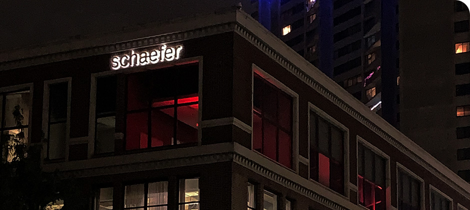 View of Schaefer's downtown Cincinnati office lit up with red lights for Red Alert #RESTART.