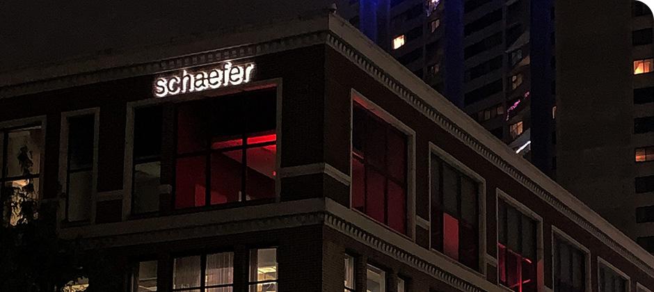 View of Schaefer's downtown Cincinnati office lit up with red lights for Red Alert #RESTART.