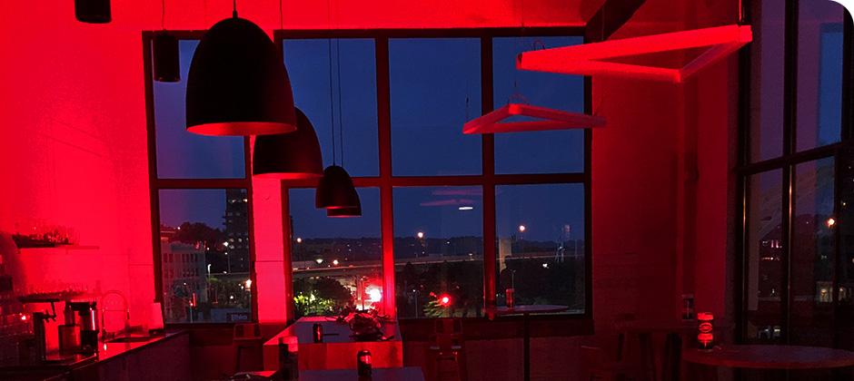 Schaefer's downtown Cincinnati office cafe area lit up with red lights for Red Alert #RESTART.