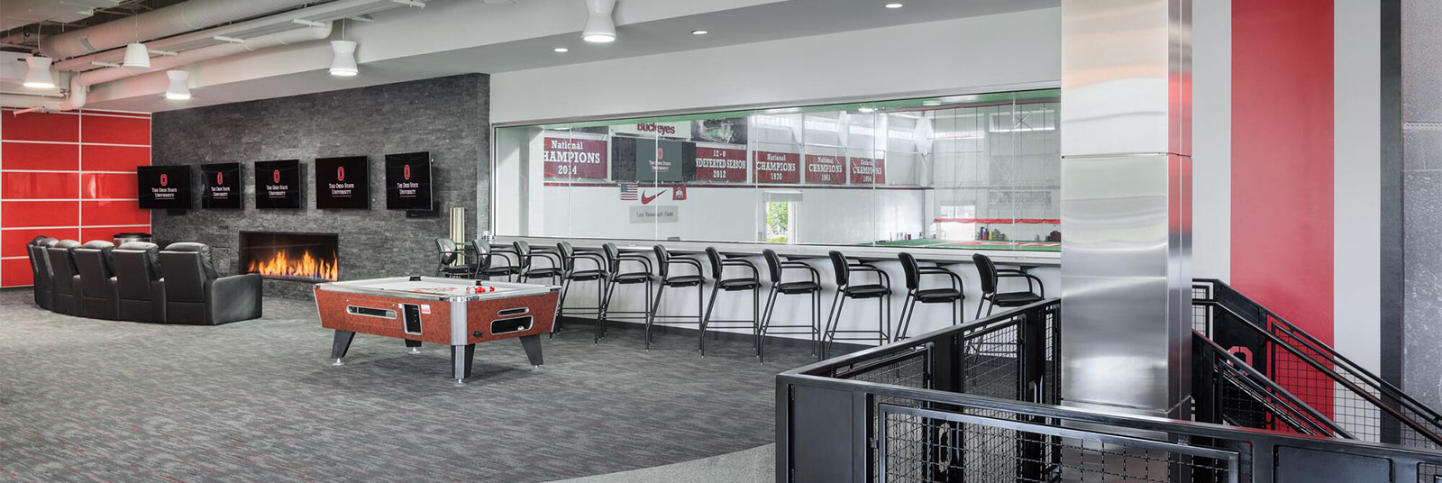 View of the upstairs player lounge area with window overlooking recreation room at the renovated Woody Hayes Athletic Center at The Ohio State University.