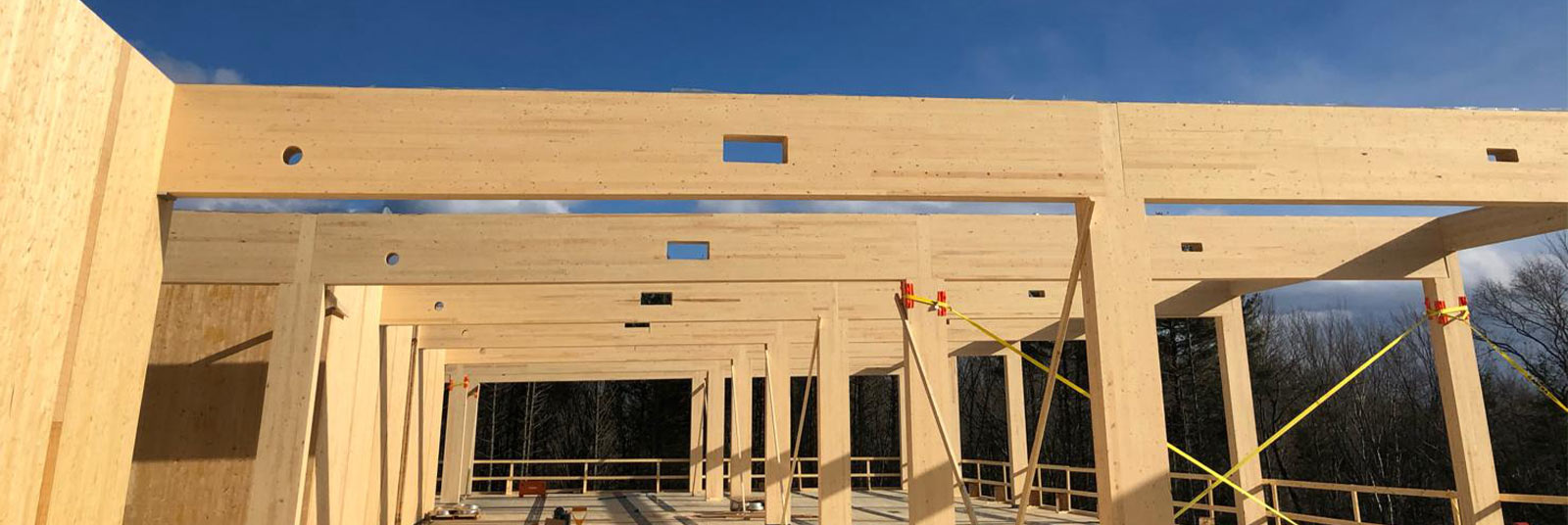 Construction at 90 Arboretum - a mass timber frame office building in Newington, New Hampshire.