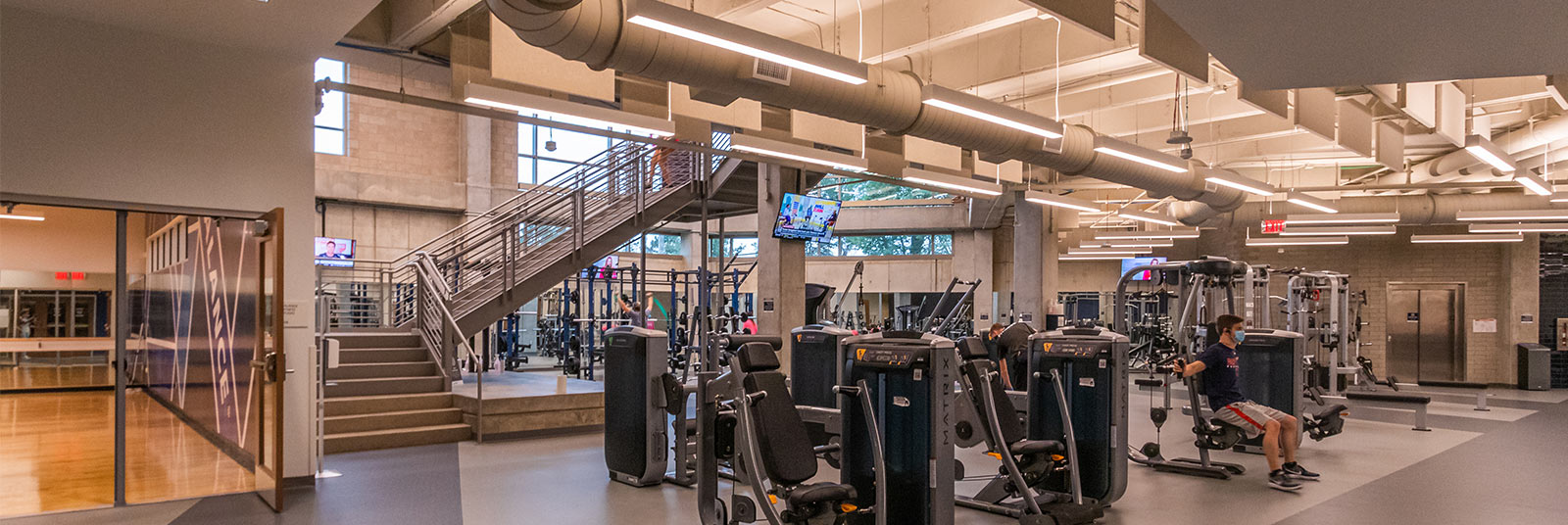 Two-story fitness center in the Health United Building at Xavier University.