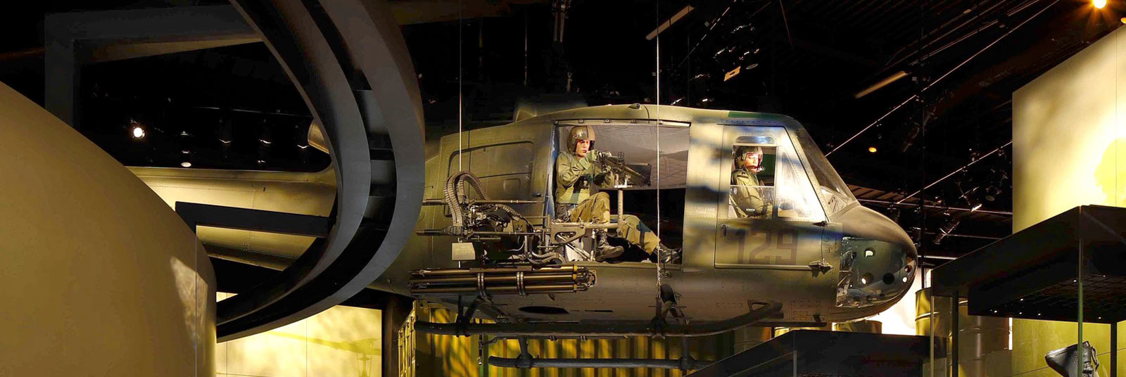 Exhibit space inside the National Museum of the United States Army featuring a helicopter suspended from the ceiling.