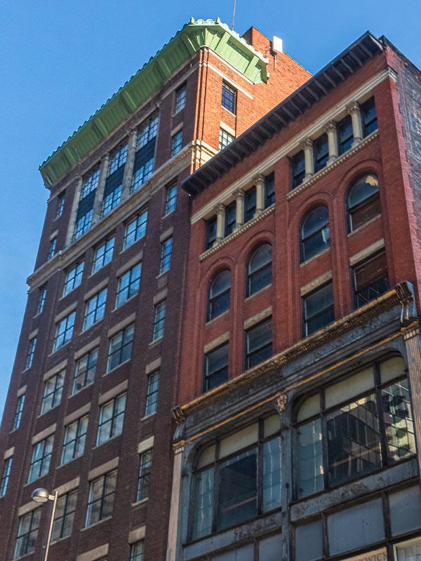 Looking up at the historic Reakirt + Brunswick buildings in downtown Cincinnati, Ohio.